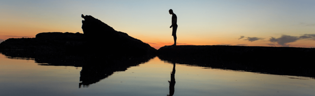 silhouette of man at sunset on laguna beach
