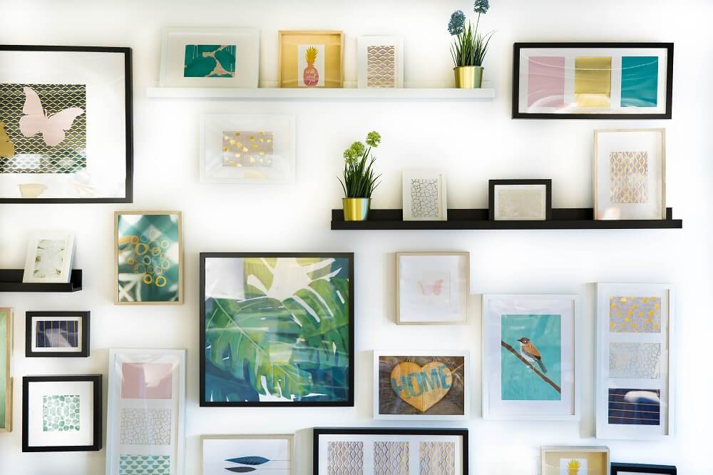 gallery wall of hanging art