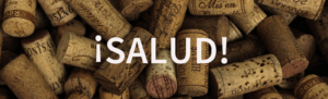 salud on background of wine corks