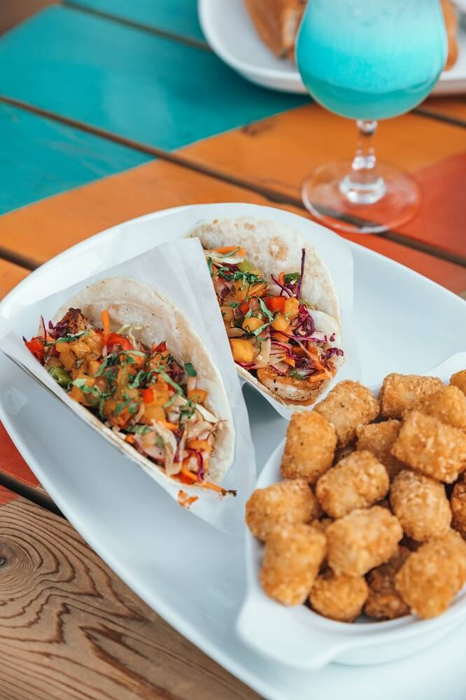 two fish tacos with tater tots