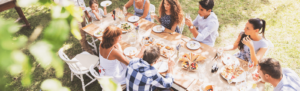multigenerational outdoor gathering around table