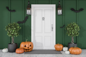 pumpkins on ground around white front door
