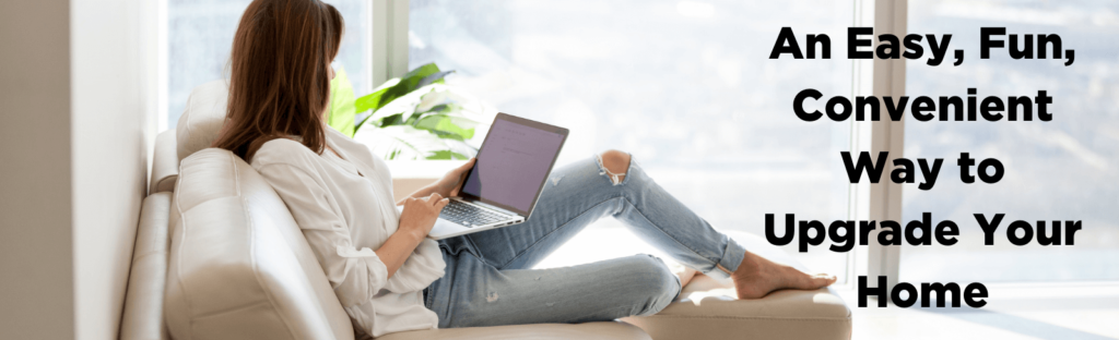 woman sits on couch looking at laptop
